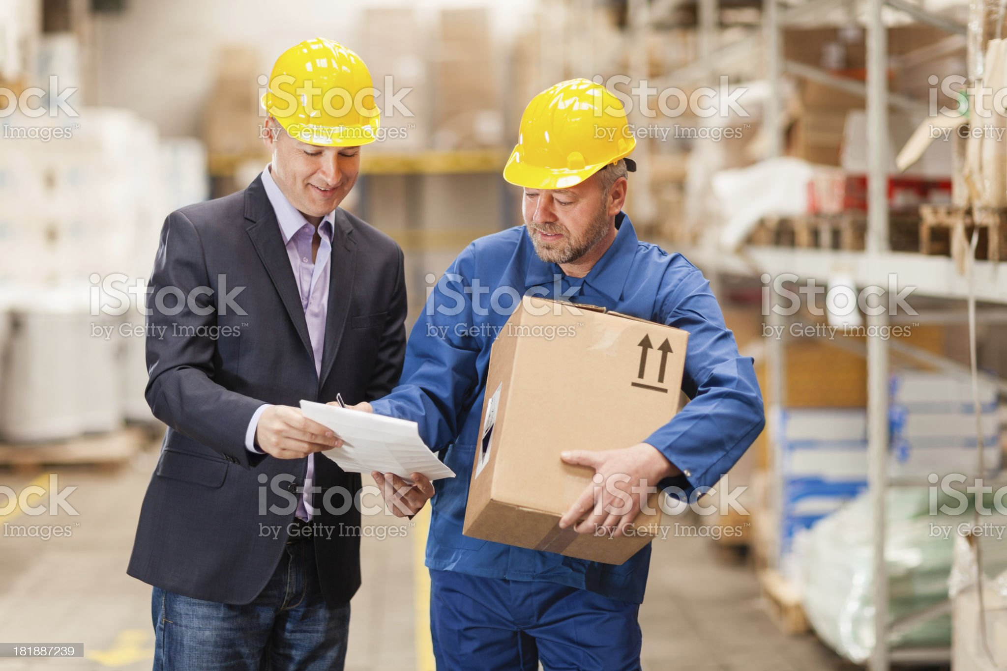 Warehouse worker signing document royalty-free stock photo
