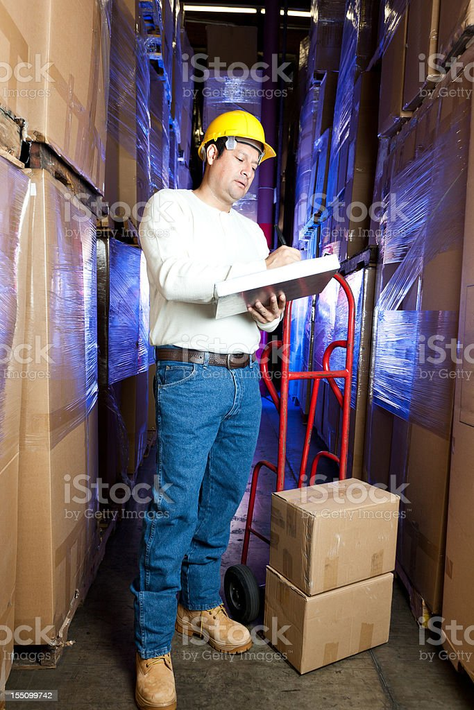 Warehouse worker singing paperwork royalty-free stock photo
