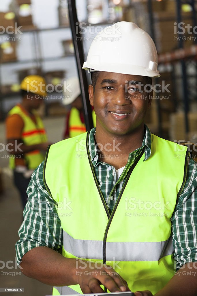 Warehouse worker using digital tablet at work royalty-free stock photo
