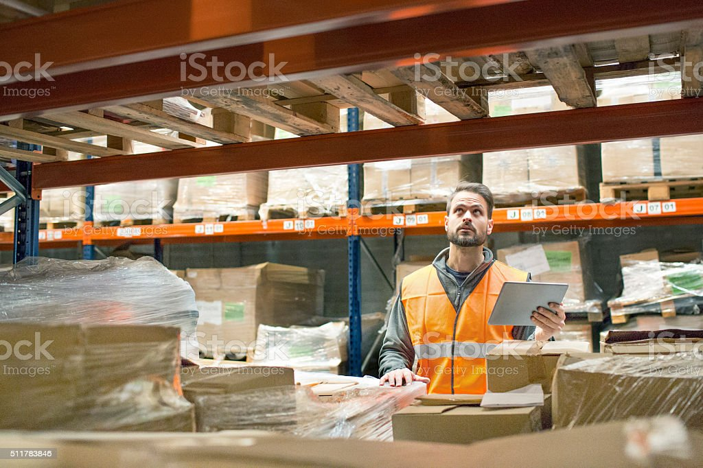 Warehouse worker with digital tablet stock photo