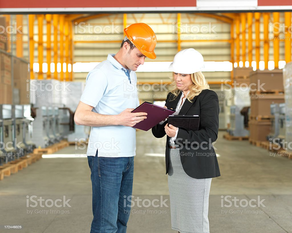 Warehouse Workers and Inspector royalty-free stock photo