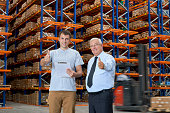 Warehouse workers giving thumbs up