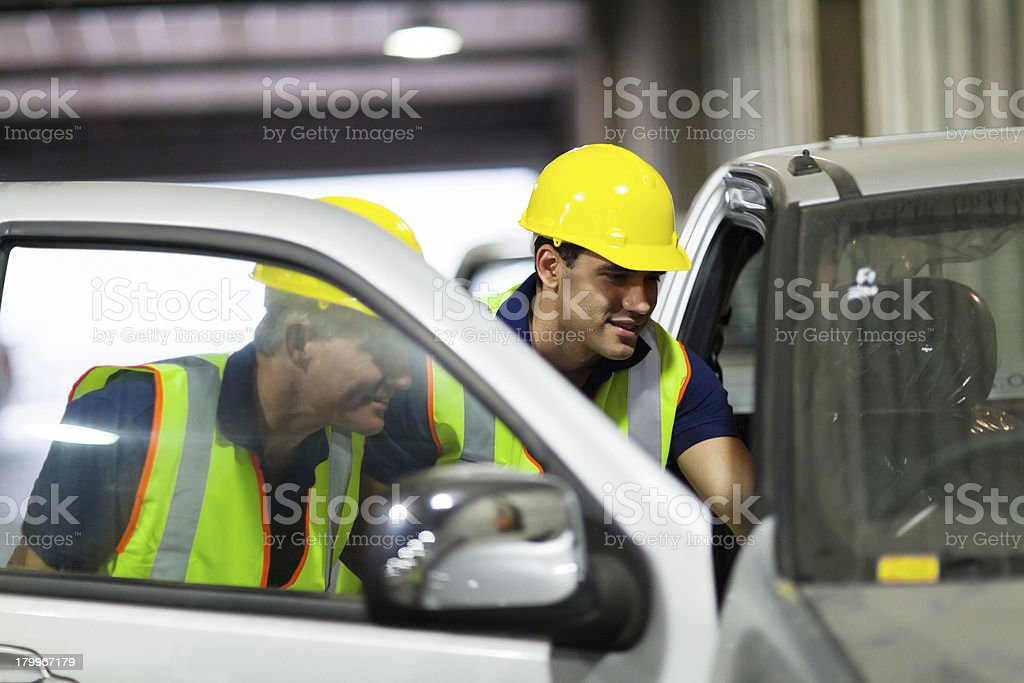warehouse workers inspecting vehicle royalty-free stock photo