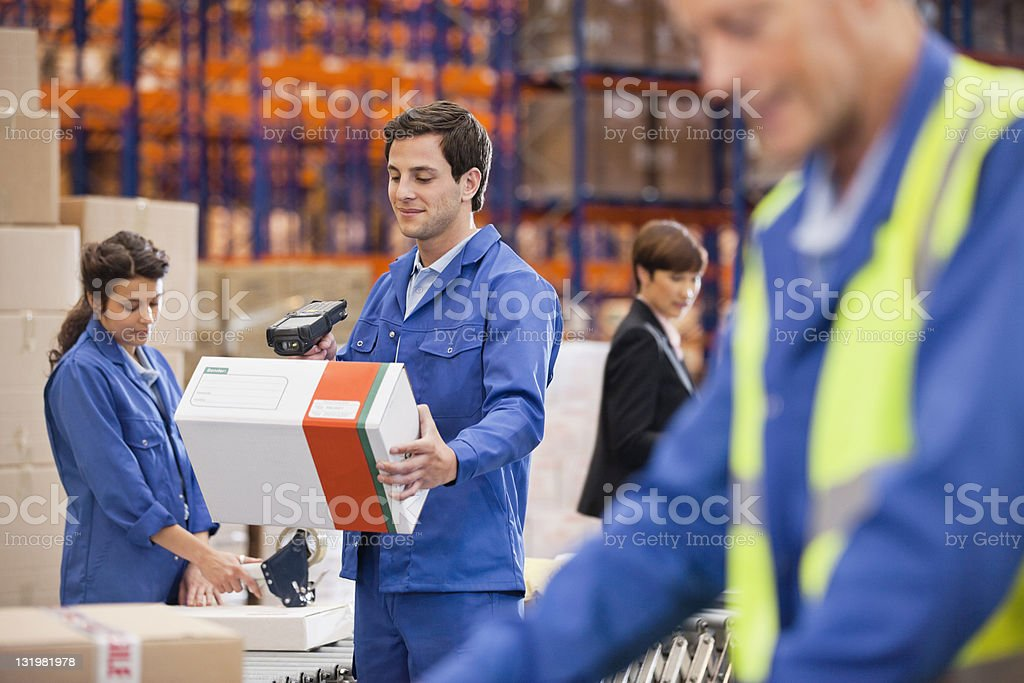 Warehouse workers working stock photo