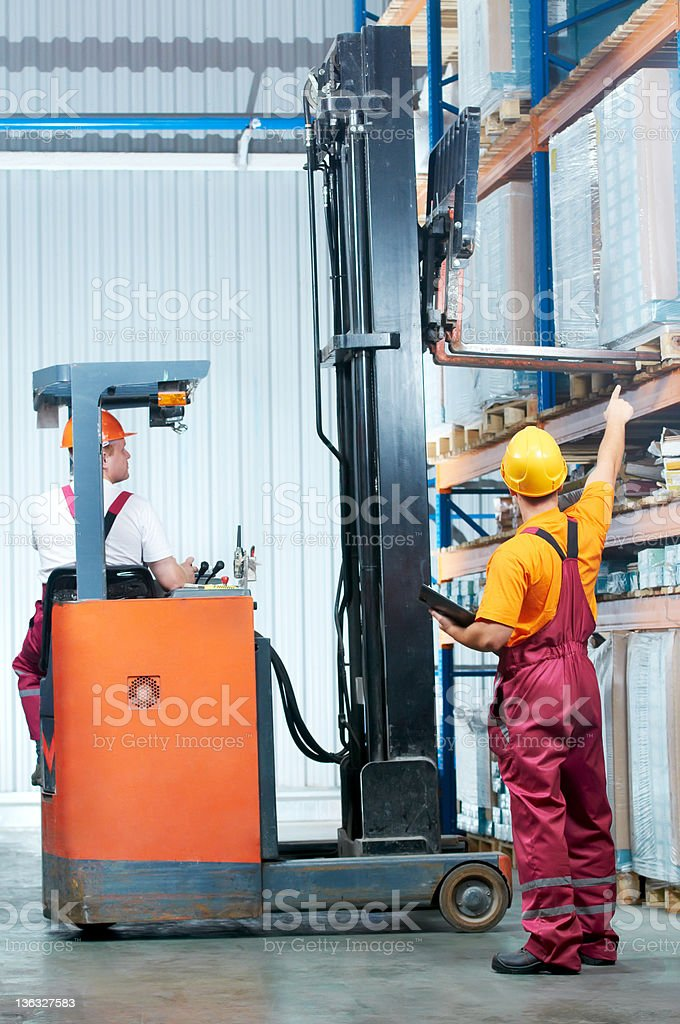 warehouse works (forklift and workers) royalty-free stock photo