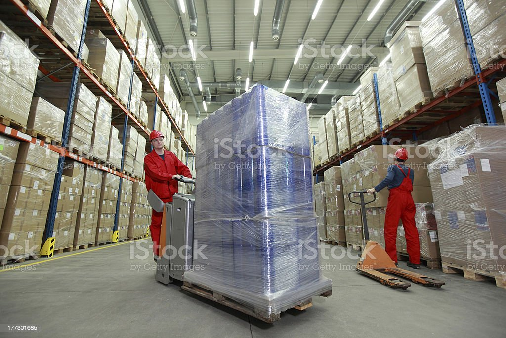 warehousing two workers working in storehouse royalty-free stock photo