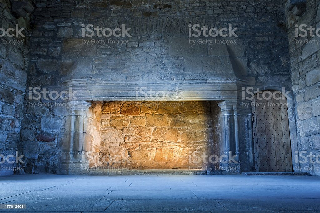 Warm and cold light in medieval castle stock photo