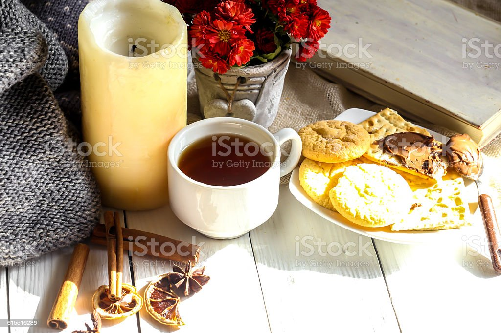 Warm and cozy,  concept.Still life a candle  tea . stock photo