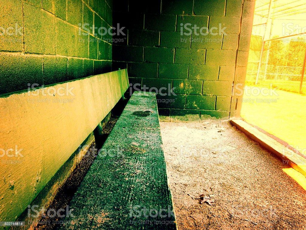 Warm baseball dugout at a little league field stock photo