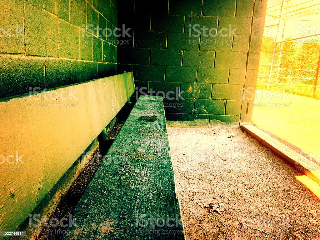 Warm baseball dugout at a little league field stock photo