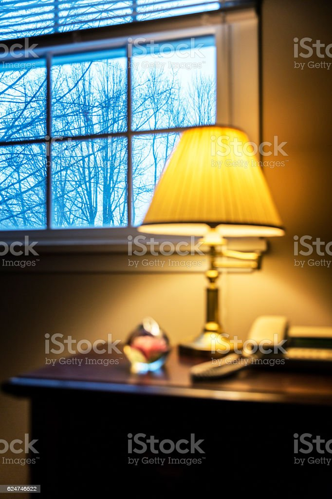 Warm Bedroom Light and Cold Winter Outside Window stock photo