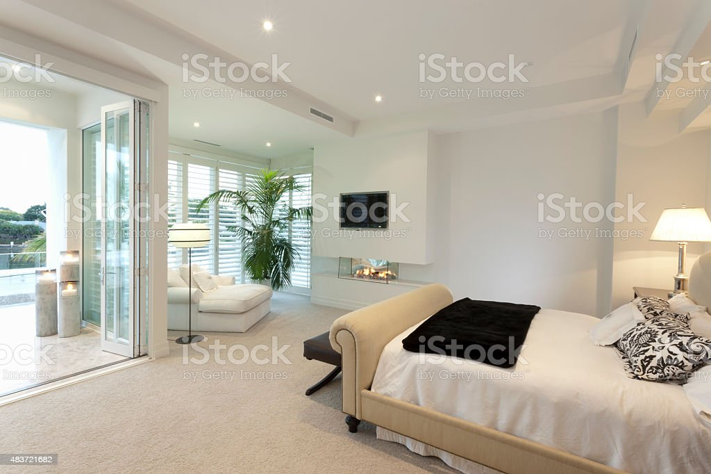 Warm bedroom with a terrace stock photo