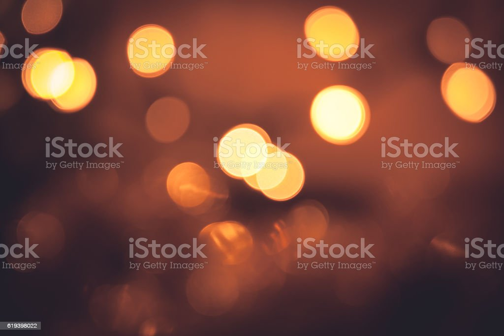 Warm bokeh with sparkling Christmas lights in orange colors stock photo