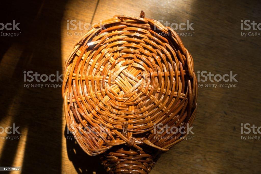 Warm brown rod circular weave texture stock photo