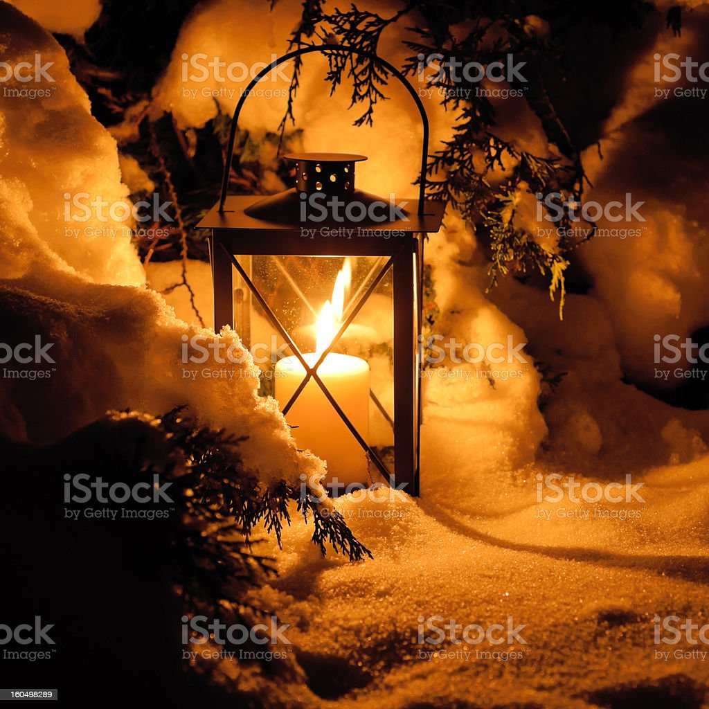 Warm candlelight in the snow royalty-free stock photo