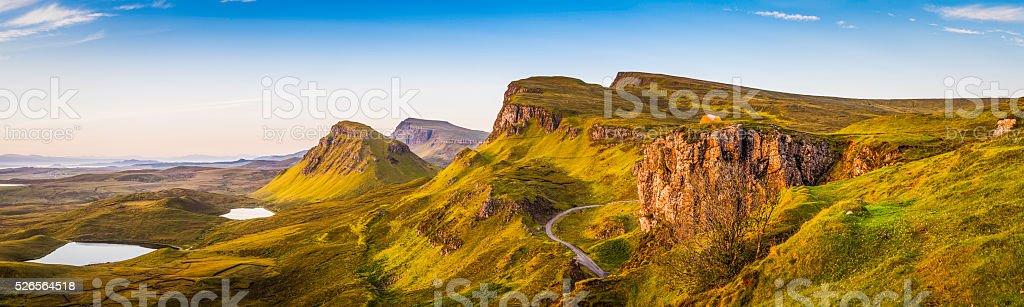 Warm dawn light on idyllic mountain landscape panorama Skye Scotland stock photo