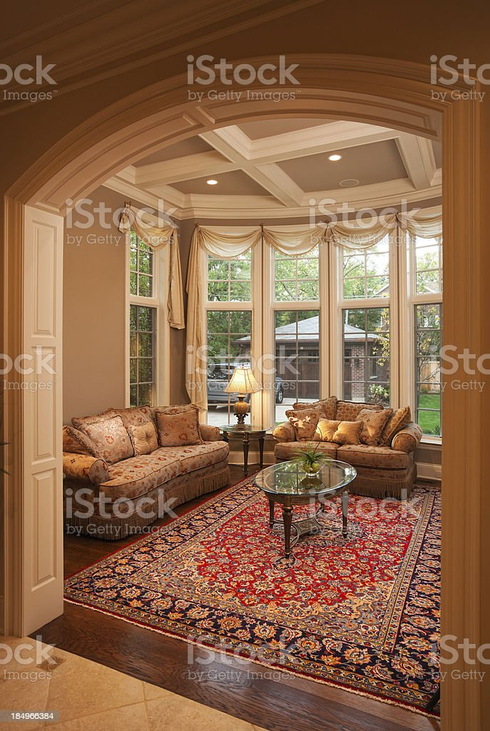 Warm elegant formal living room with windows. royalty-free stock photo