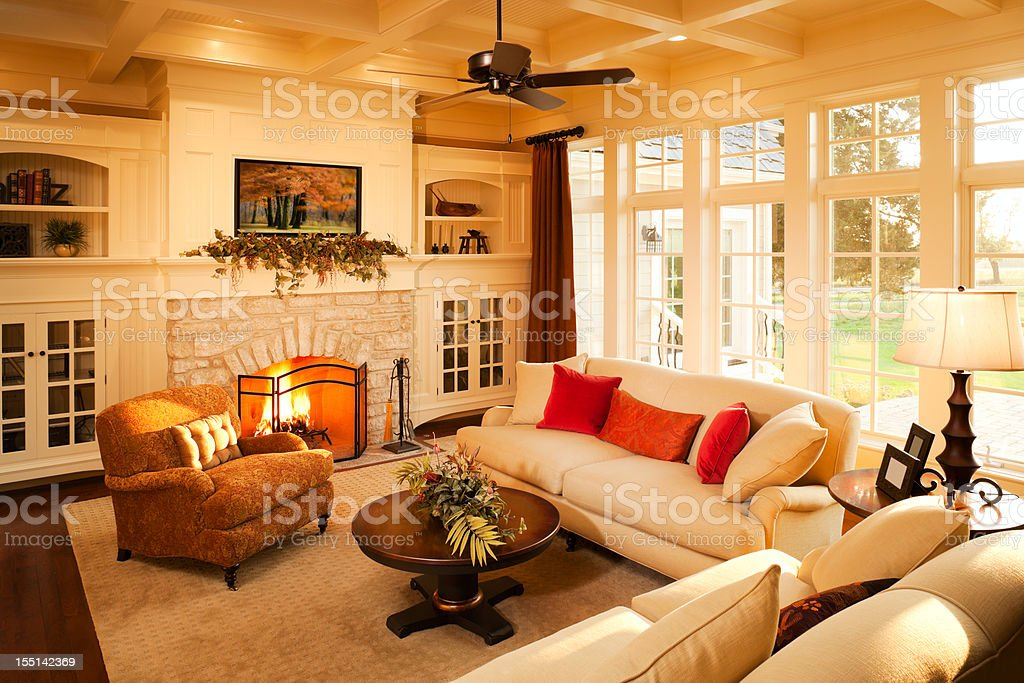 Warm elegant sunlit living room. stock photo
