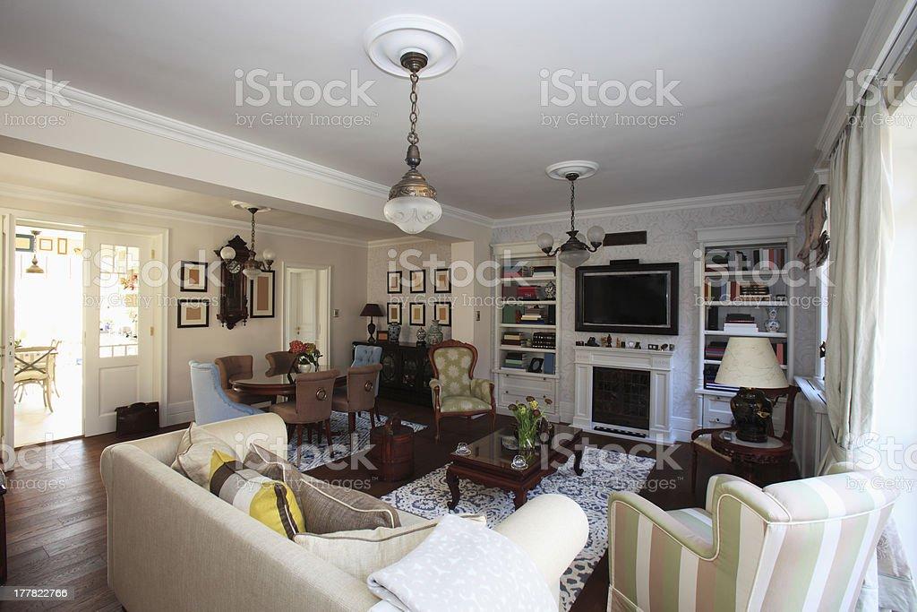 A warm, elegant sunlit living room stock photo