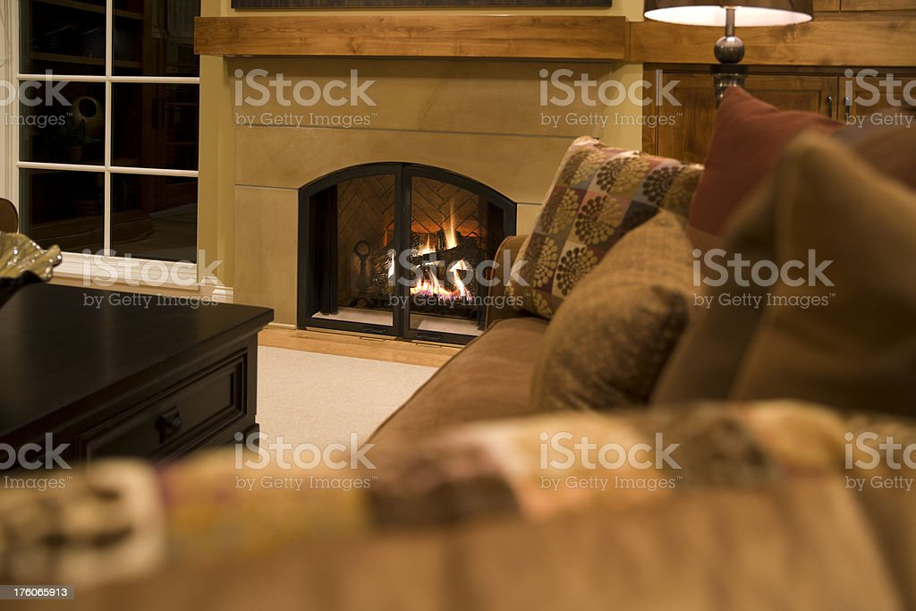 Warm gas fireplace and relaxing living room. royalty-free stock photo