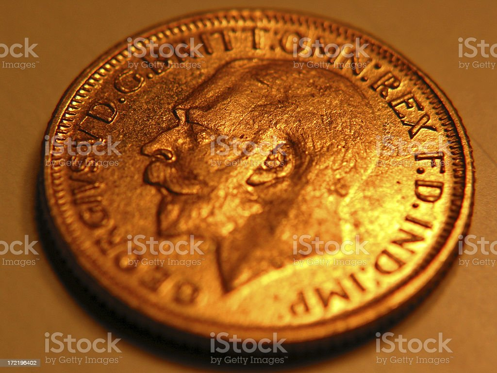 Warm glow of a gold coin royalty-free stock photo