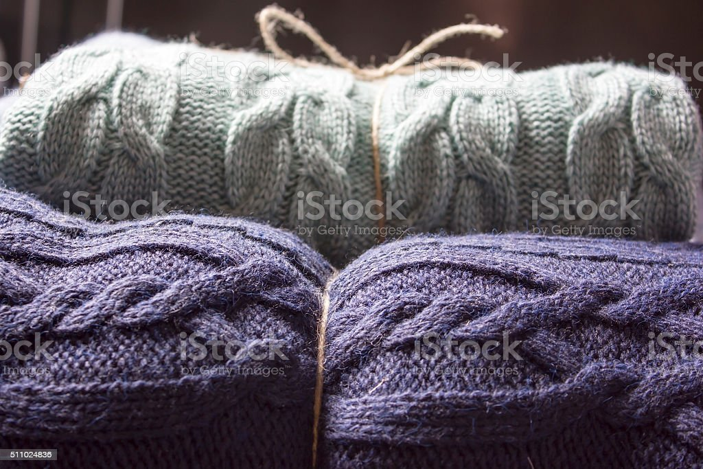 Warm knitted blankets folded stack. Comfort and convenience stock photo