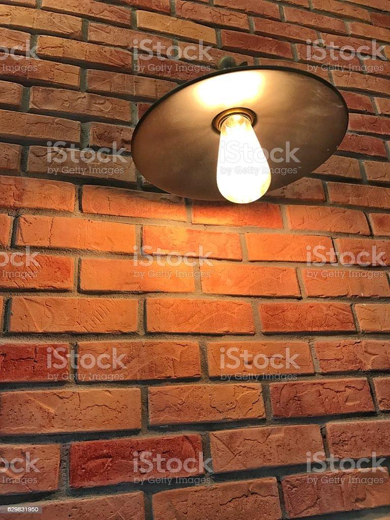 warm light with brick wallpaper stock photo