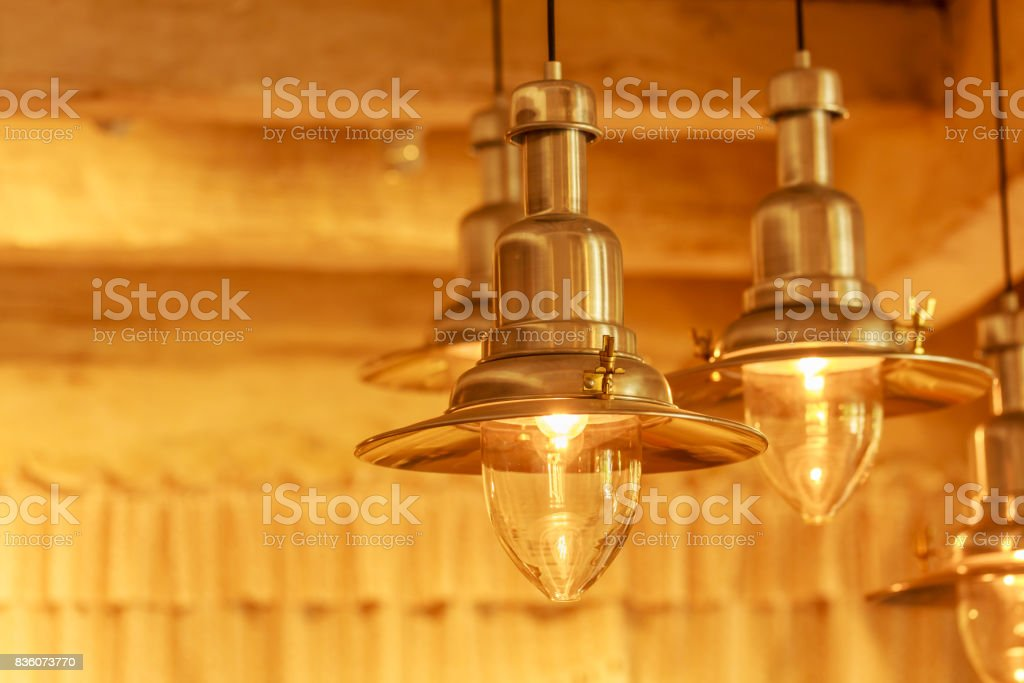 Warm lighting modern ceiling lamps in the cafe and interior decoration restaurant stock photo