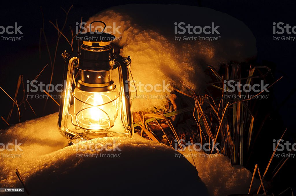 Warm oil lamps light in the snow royalty-free stock photo