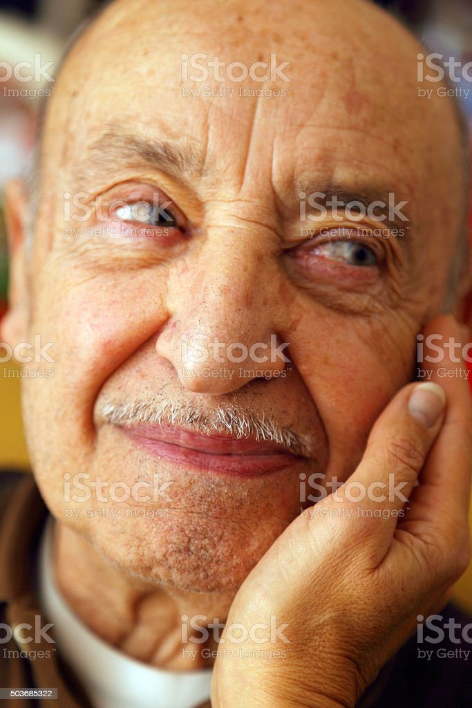 Warm pat in elderly person stock photo