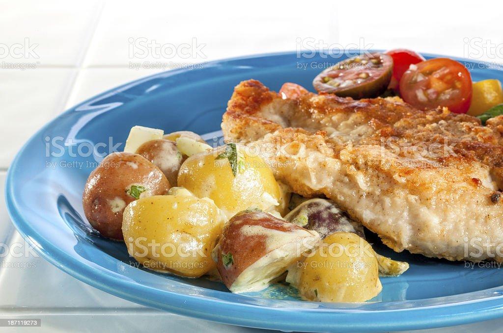Warm Potato Salad and Chicken Paillard stock photo