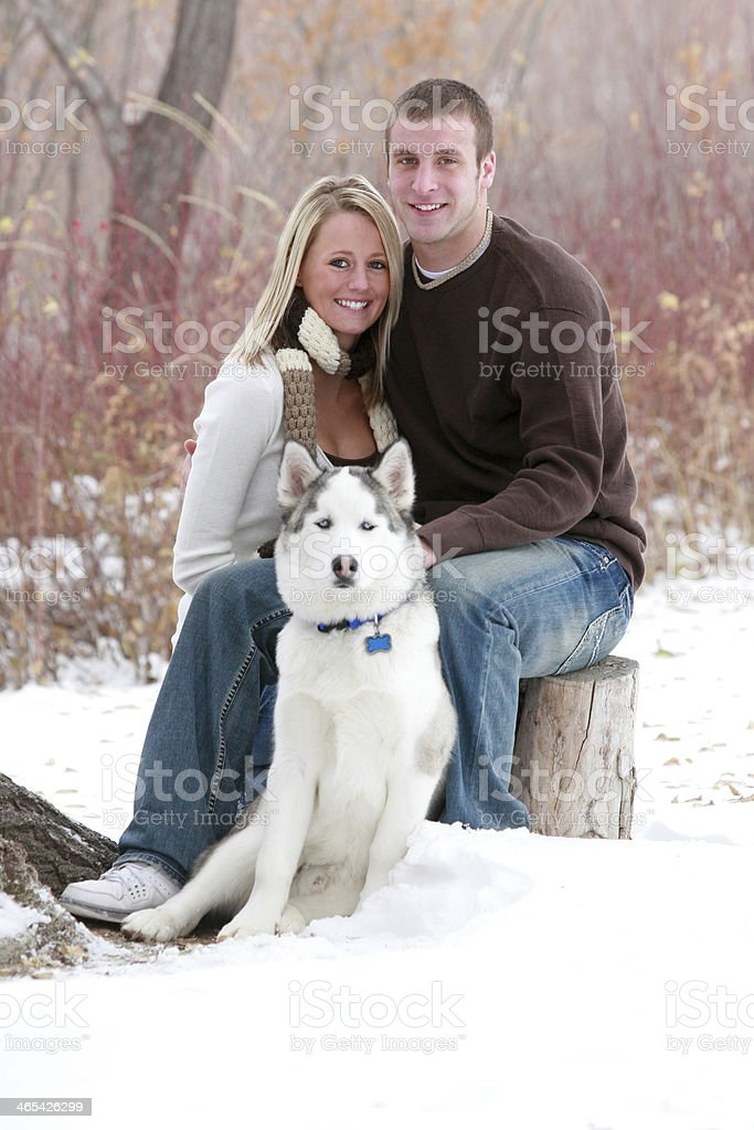 Warm smiles on a wintery day royalty-free stock photo