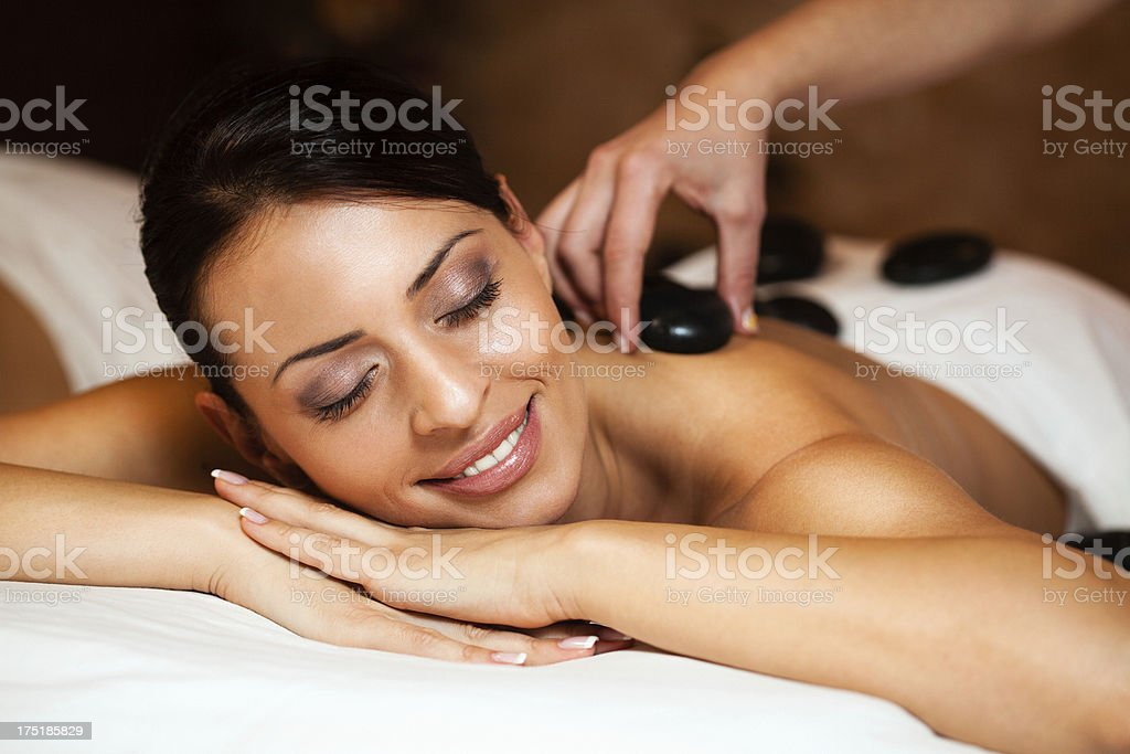 Warm stones massage stock photo