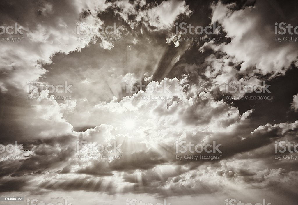 Warm Sun Filtering Through Clouds royalty-free stock photo