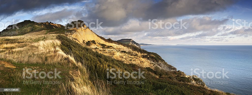 Warm sunshine rakes across the Dorset Jurassic Coast at sunset stock photo