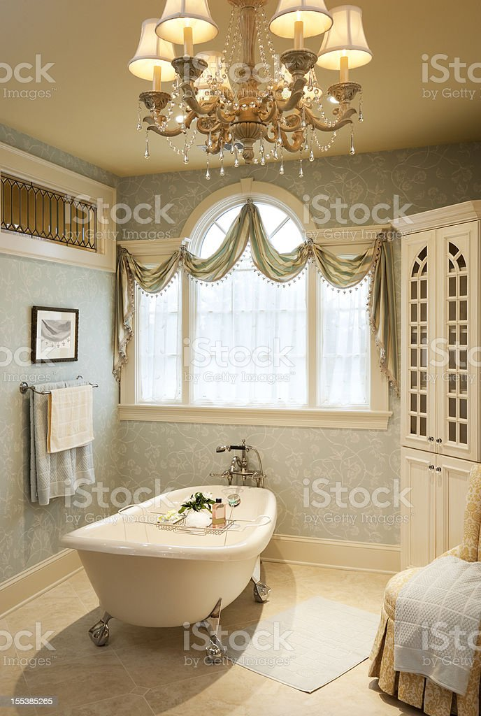 Warm traditional styled master bath with clawfoot. royalty-free stock photo
