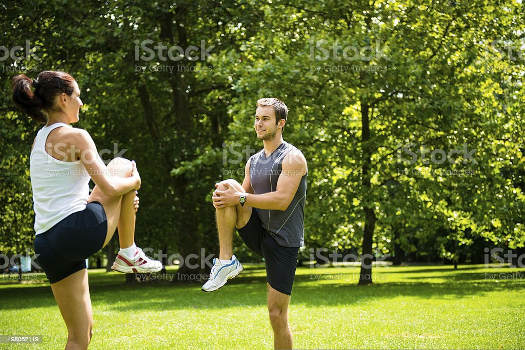 Warm up - couple exercising before jogging royalty-free stock photo