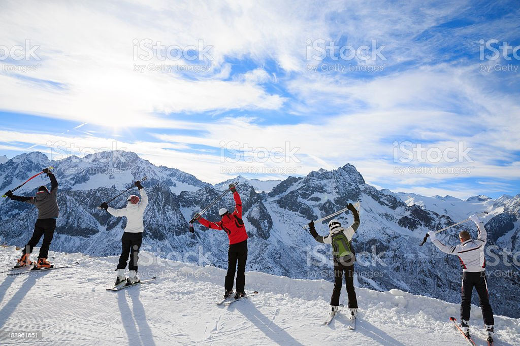 Warm Up. Stretching before a skiing class on the mountain slope....