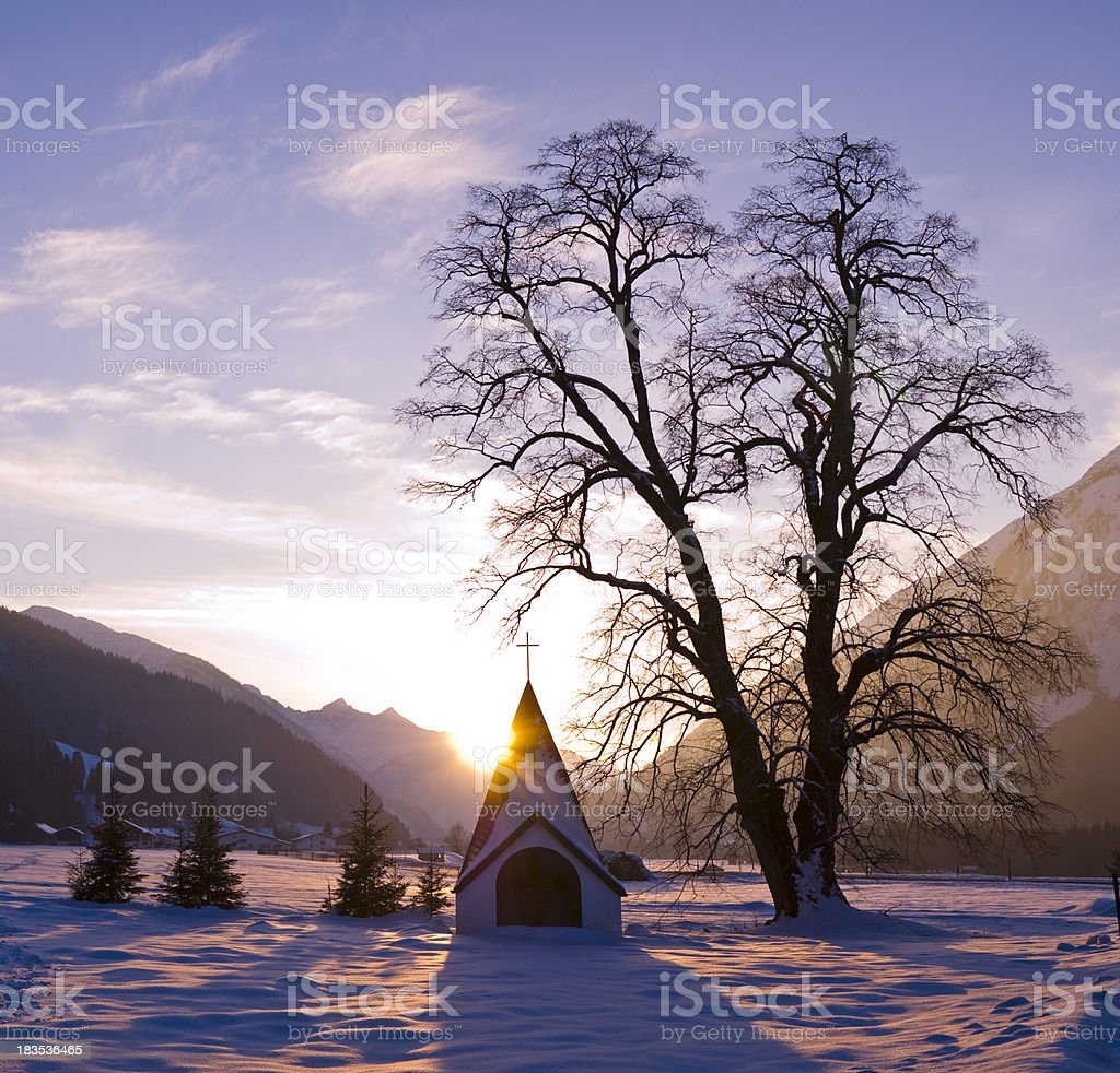 Warm violet Sun near little church and tree royalty-free stock photo