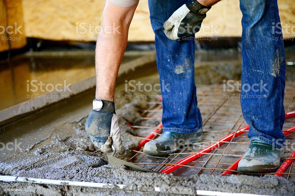 Warm water floor,pouring concrete floor stock photo