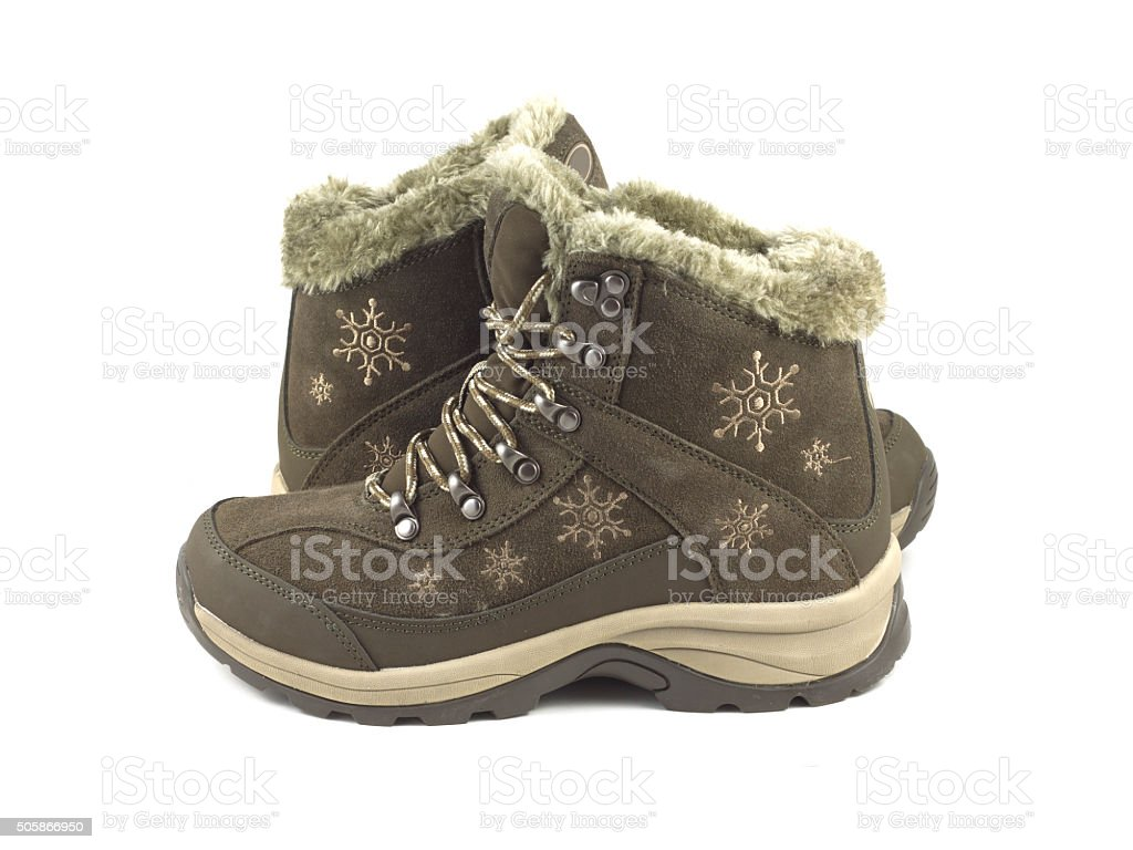 Warm winter feamle boots isloated on white stock photo