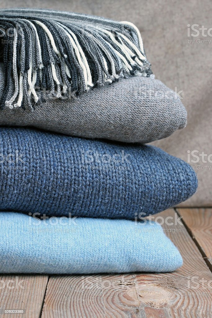 Warm wool clothing on a table stock photo