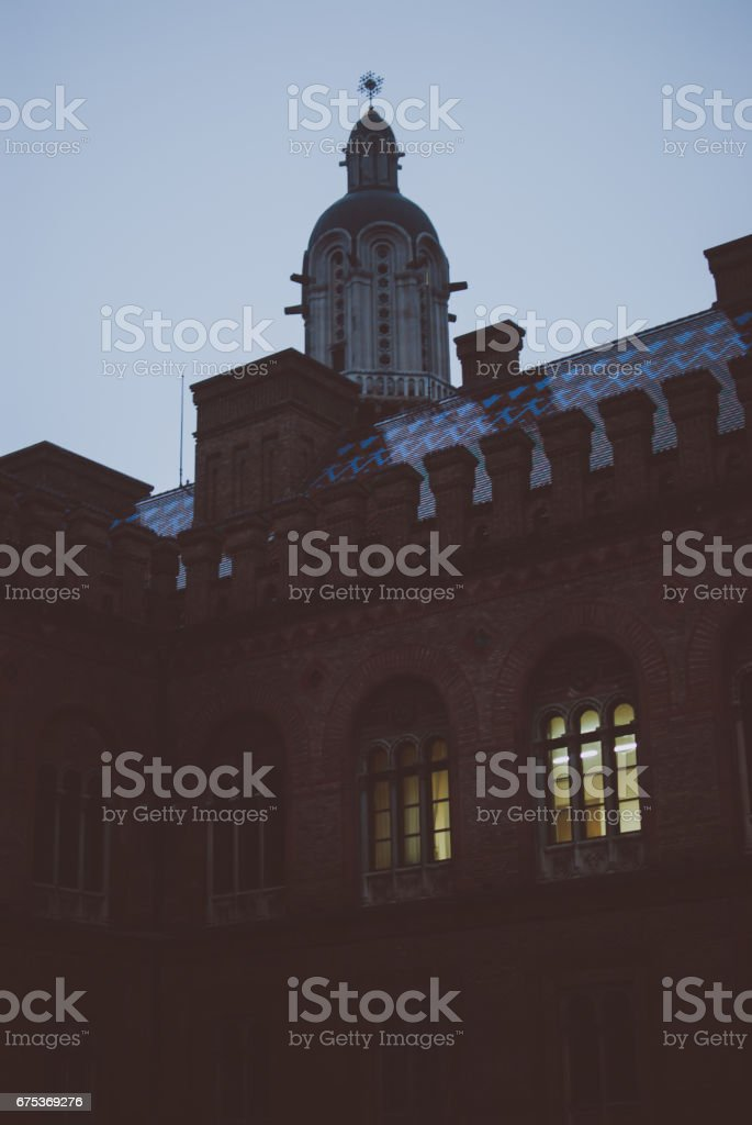 Warm yellow light in the windows. stock photo
