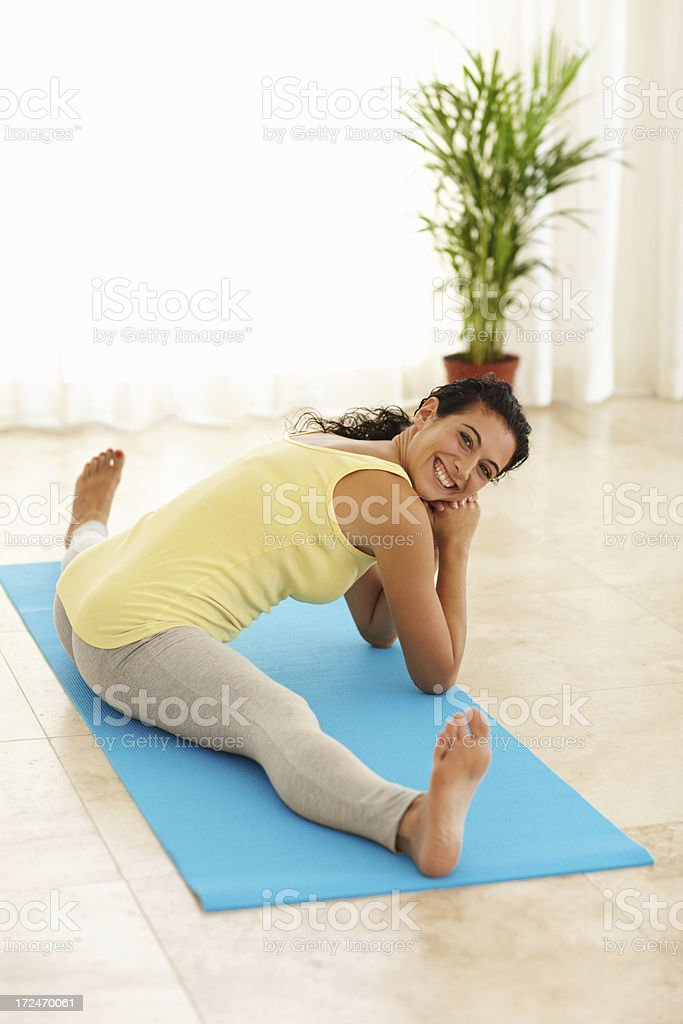 Warming down with a few stretches royalty-free stock photo