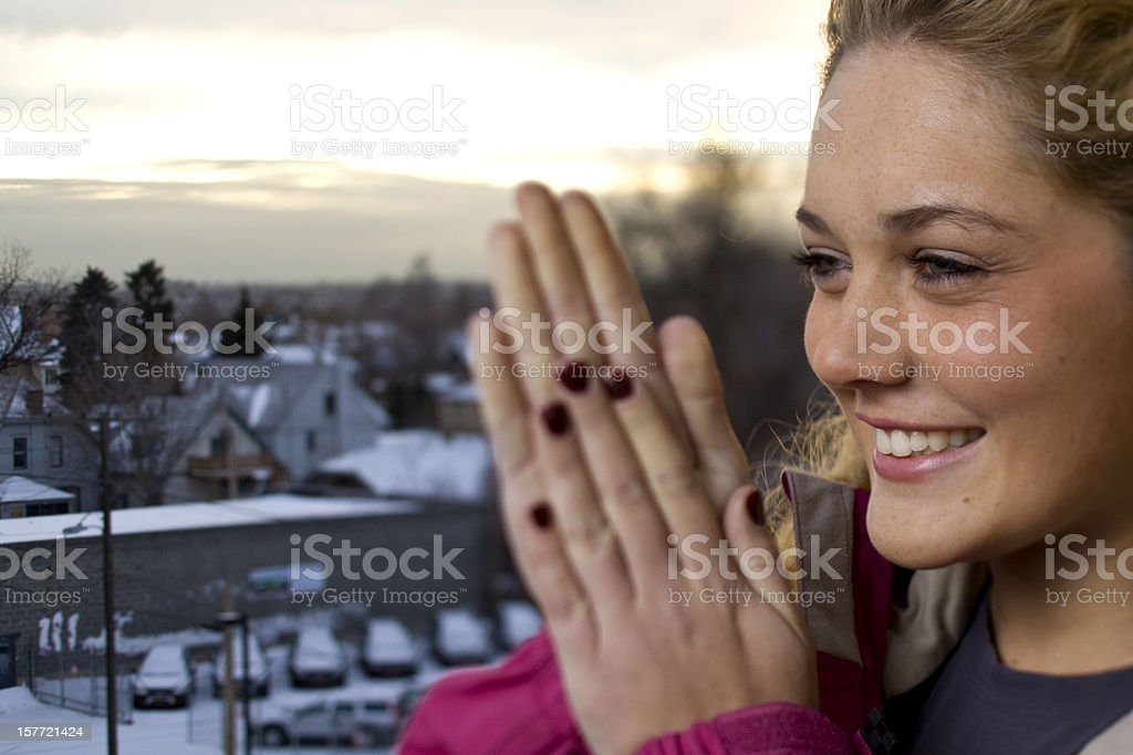 warming her hands royalty-free stock photo