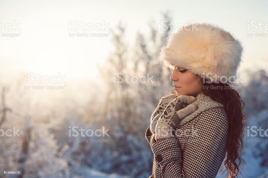 Warming on winter sun rays stock photo