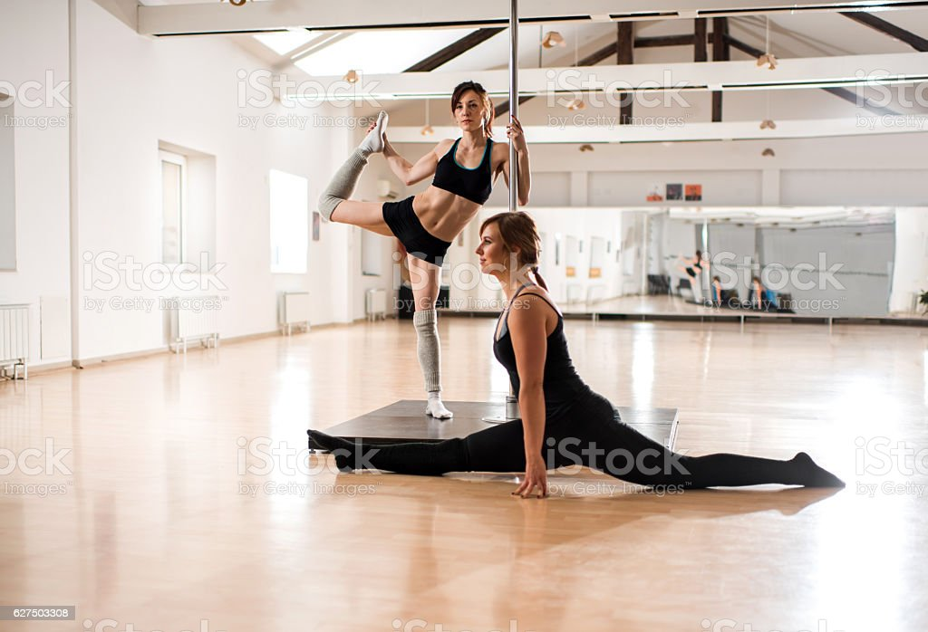 Warming up before pole dancing! stock photo