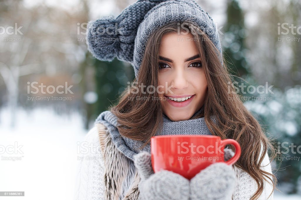 Warming up of gorgeous young woman in winter stock photo
