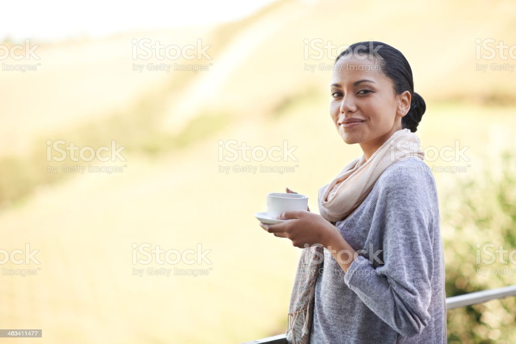 Warming up with a coffee and the sunrise stock photo