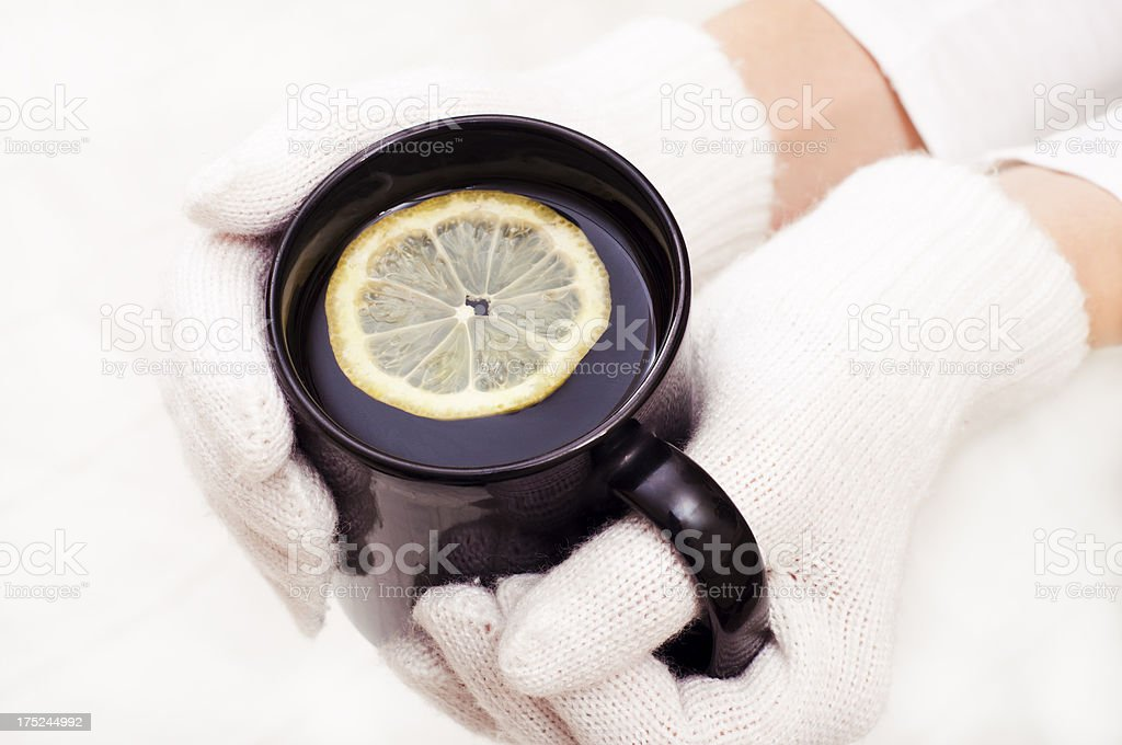 Warming up with a hot tea royalty-free stock photo